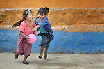 """Girls play basketball during a 2014 recess from school in Tuixcajchis, a small Mam-speaking Maya village in Comitancillo, Guatemala. Under """"informed consent"""" rules that require prior approval, the photographer would have had to stop the girls from playing, have them identify their parents, explain the intricacies of """"informed consent"""" and usage, get their signature, and then be able to photograph the girls. That's a process that's allegedly designed to assure that the girls are not depicted in an undignified manner. Photo by Paul Jeffrey."""