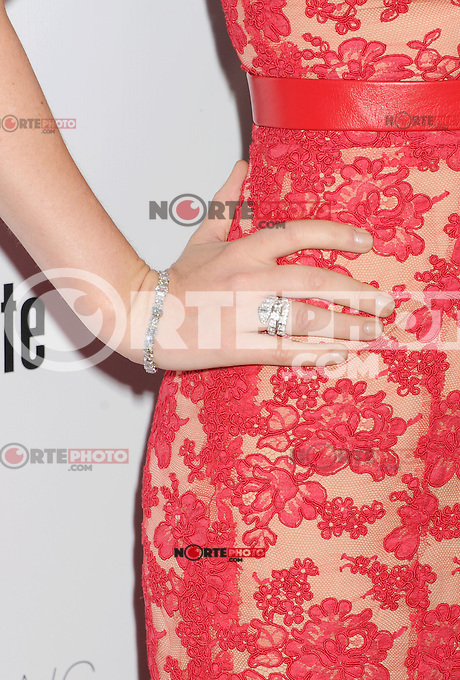 HOLLYWOOD, CA - AUGUST 23: Isla Fisher arrives at the Los Angeles premiere of 'Bachelorette' at the Arclight Hollywood on August 23, 2012 in Hollywood, California. /NortePhoto.com<br />