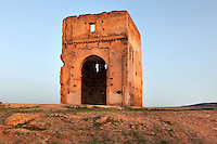 Low angle view of arch, Merenid Tombs, 14th century, Fez, Morocco, pictured on February 25, 2009 in the morning. The tombs, built for the Merenid sultans and now in ruins, are situated on the hillside north of Fez, Morocco's second largest city, and one of the four imperial cities, which was founded in 789 by Idris I on the banks of the River Fez. The oldest university in the world is here and the city is still the Moroccan cultural and spiritual centre. Fez has three sectors: the oldest part, the walled city of Fes-el-Bali, houses Morocco's largest medina and is a UNESCO World Heritage Site;  Fes-el-Jedid was founded in 1244 as a new capital by the Merenid dynasty, and contains the Mellah, or Jewish quarter; Ville Nouvelle was built by the French who took over most of Morocco in 1912 and transferred the capital to Rabat. Picture by Manuel Cohen.