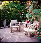 wooden chairs on a patio in an outdoor room in a garden in the Pacific Northwest