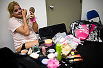 Lucha Libre AAA wrestler Pimpinela puts on makeup  before a match in Sacramento, CA March 28, 2009.
