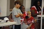 Ole Miss offensive lineman derrick Wilson (center) poses with fans Taylor Franks (left) and Jake Johnston at Meet The Rebels in Oxford, Miss. on Saturday, August 18, 2012.