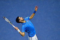 NEW YORK, USA - SEPT 11, Novak Djokovic of Serbia serves to Stan Wawrinka of Switzerland during their Men's Singles Final Match of the 2016 US Open at the USTA Billie Jean King National Tennis Center on September 11, 2016 in New York.  photo by VIEWpress