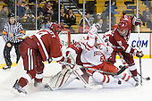 Peter Starrett (Harvard - 14), Ryan Carroll (Harvard - 35), Joe Pereira (BU - 6), Danny Biega (Harvard - 9) - The Harvard University Crimson defeated the Boston University Terriers 5-4 in the 2011 Beanpot consolation game on Monday, February 14, 2011, at TD Garden in Boston, Massachusetts.