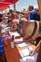 Surfers signing up for the Save Kirra paddle out.Kirra Beach, Queensland, Australia.   Monday January 26 2009..Over one thousand five hundred people paddled out at Kirra Beach today to protest the loss of the world famous surfing location Kirra Point. The Australia Day  Paddle Out focused  community attention on the wipeout of Kirra Point due to the massive build up of sand from the Tweed River Sand Bypass.  Photo: joliphotos.com