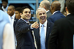 28 December 2015: UNC head coach Roy Williams (right) with former player and current UNCG head coach Wes Miller (left). The University of North Carolina Tar Heels hosted the UNC Greensboro Spartans at the Dean E. Smith Center in Chapel Hill, North Carolina in a 2015-16 NCAA Division I Men's Basketball game. UNC won the game 96-63.