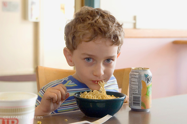 Berkeley CA Boy, four-years-old enjoying nutritious pasta dish MR