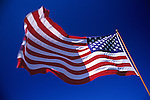 American Flag Stars and Stripes waving in the wind with blue sky Lynnwood Washington State USA