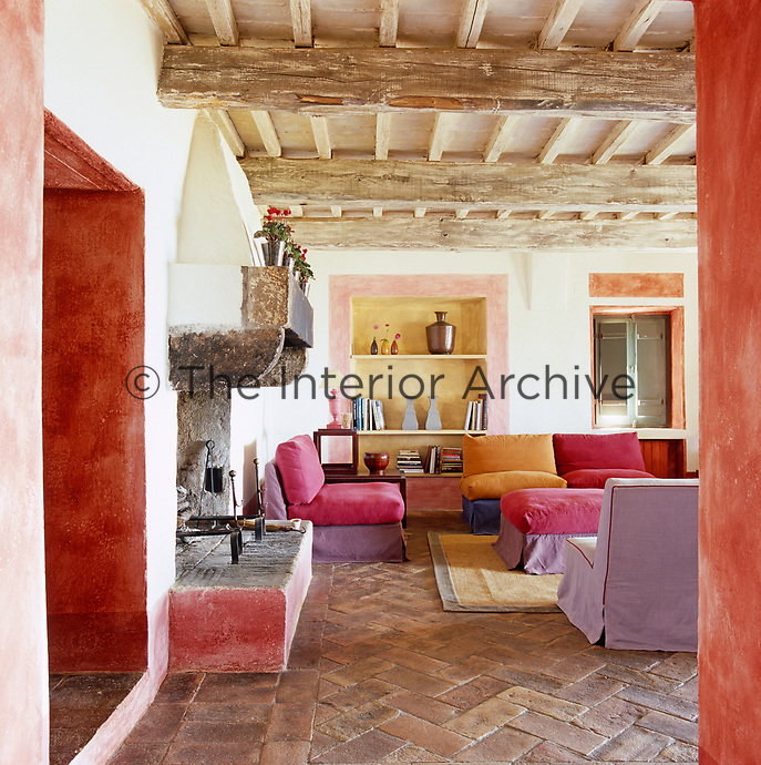 The colourful chairs in the living room compliment the bold paint effects used in its decoration
