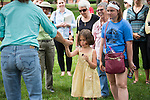 Beatrice Zulia- Davis, 6, examines a leaf from a weetgum tree as part of a tree tour on the College Green on June 19, 2015. Photo by Ben Siegel
