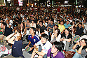June 19, 2010 - Tokyo, Japan - Japanese fans watch the public viewing of the 2010 World Cup football match Netherlands vs Japan at Shibuya district in Tokyo, Japan, on June 19, 2010. The Netherlands defeated Japan 1-0.