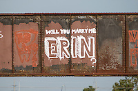 """""""Will You Marry Me Erin?"""" is a marriage proposal graffiti painting on the Austin Railroad Graffiti Bridge over Lady Bird Lake in downtown Austin, Texas."""