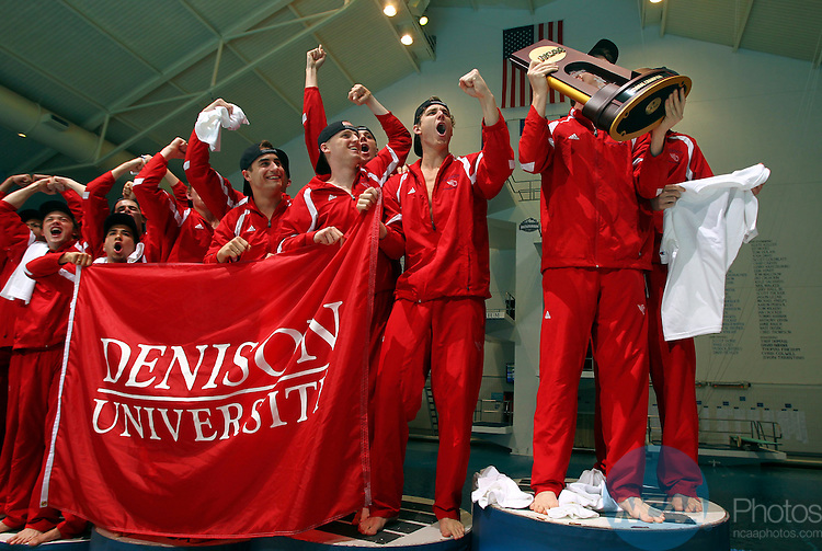 24 MAR 2012:  Members of Denison University men's swimming and diving team celebrate winning the Div III National Championship. Michael Hickey/NCAA Photos