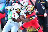 Buckeyes' Ezekiel Elliot gain big yards against the Terrapins. Ohio State trounced Maryland 52-24 during a game at the Capital One Field in Byrd Stadium, College Park, MD on Saturday, October 4, 2014.  Alan P. Santos/DC Sports Box