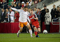 07 May2011: Houston Dynamo midfielder Geoff Cameron #20 and Toronto FC defender Richard Eckersley #27 in action during an MLS game between the Houston Dynamo and the Toronto FC at BMO Field in Toronto, Ontario..Toronto FC won 2-1.