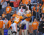 Ole Miss wide receiver Melvin Harris (5) is called for pass interference as he is defended by Tennessee defensive back Anthony Anderson (36) and Tennessee defensive back Tyler Wolf (18) in a college football game at Neyland Stadium in Knoxville, Tenn. on Saturday, November 13, 2010. Tennessee won 52-14.