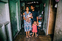 George Junior (24) a health worker at the Ebeye public hospital with his wife Angela (23) and children Angeline (2) and Brangie (2 months) in their house. George says that every time the U.S. military test their ballistic missiles and the rains fall, all the population of Ebeye gets sick with diarrhoea, conjunctivitis and flu.