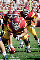 7 October 2006: #67 Ryan Kalil getting ready to hike the ball to quarterback John David Booty and the offensive line.  NCAA College Football Pac-10 USC Trojans 26-6 win over the Washington Huskies at the LA Coliseum during a sunny saturday game in Los Angeles, CA.<br />