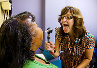 The Adult Down Syndrome Clinic at the University of Alabama in Birmingham is one of few facilities in America focusing on Down Syndrome.   Dr. Vickie Moore encourages Ingrid Kidd to open wide so she can see her throat during her exam.  Photo by Gary Cosby Jr.  9/16/09