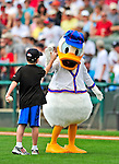 "12 March 2009: Walt Disney character Donald Duck gives a ""high five"" to a youngster who was selected to throw out the ceremonial first pitch prior to a Spring Training game between the Washington Nationals and the Atlanta Braves at Disney's Wide World of Sports in Orlando, Florida. The Braves defeated the Nationals 6-2 in the Grapefruit League matchup. Mandatory Photo Credit: Ed Wolfstein Photo"