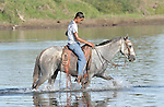 A boy crosses a river on his horse in northwestern Nicaragua.