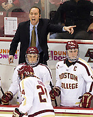 Mike Cavanaugh (BC - Associate Head Coach), Danny Linell (BC - 10), Pat Mullane (BC - 11) - The Boston College Eagles defeated the visiting Boston University Terriers 5-2 on Saturday, December 1, 2012, at Kelley Rink in Conte Forum in Chestnut Hill, Massachusetts.