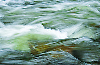 Waves of Big Creek water rushing over river boulders.