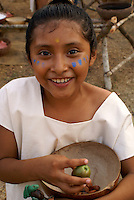 Maya girl selling cacao beans at the recreation of an ancient Mayan market, Sacred Mayan Journey 2011 event, Riviera Maya, Quintana Roo, Mexico