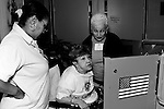 Lorna Fearon and Phyllis Weiss assist Magda L. Barreto, 77, vote .