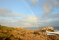 Rainbow on Ocean by a rocky shore, sunset - Hermanus, South Western Cape, South Africa