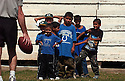A group of Iraqi orphans participate in an American football skills camp run by U.S. soldiers September 27, 2003 at the al-Taleba stadium in Baghdad, Iraq. About 70 orphans from two local orphanages participated in the camp, which was organized by members of the 800th U.S. Military Police Brigade and the U.S. Army 422 Civil Affairs Battalion.