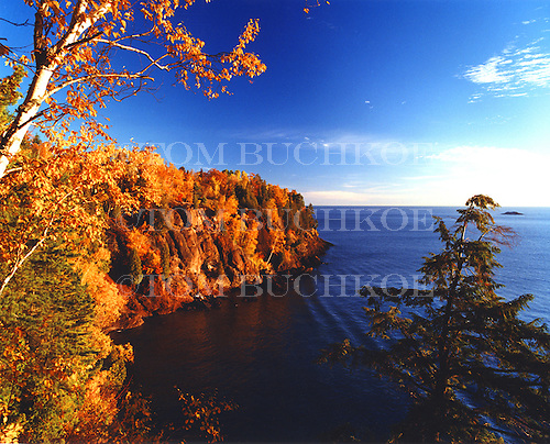 East side cliff view of Presque Isle Park in Marquette Michigan during peak fall color. Lake Superior.