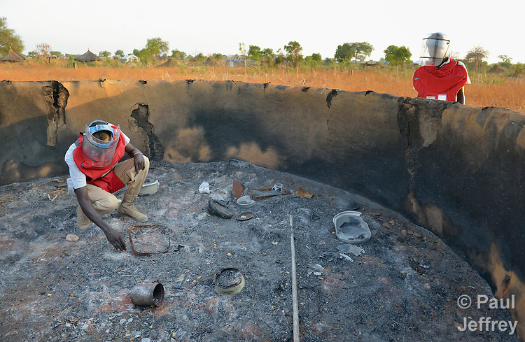 Members of an ACT Alliance team search for unexploded ordnance in the charred remains of a house near the South Sudan town of Bor, which has been the scene of heavy fighting between government troops and rebels since a dispute within the ruling party turned violent in December 2013 and quickly ripped the newly independent nation along ethnic and tribal lines. The explosive ordnance disposal team is part of the humanitarian mine action program of Dan Church Aid, a member of the ACT Alliance. The program also deploys mine risk education teams to help villagers identify and understand the dangers of unexploded ordnance and land mines from this most recent conflict as well as ordnance left over from decades of civil war.