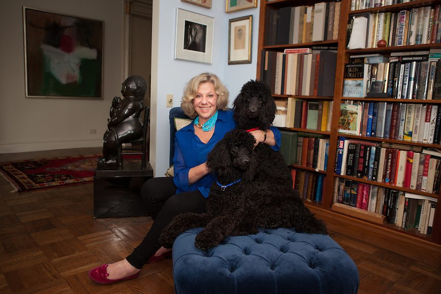 New York, NY - October 03, 2013 : Author Erica Jong with her 10-month old poodles Simone (blue collar) and Collette (red collar) at her apartment in New York, NY on October 03, 2013. Fear of Flying, celebrating its 40th anniversary, is a 1973 novel by Erica Jong, which became famously controversial for its attitudes towards female sexuality, and figured in the development of second-wave feminism.