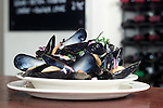 A bowl of local Morston Mussels served at The White Horse pub restaurant and Hotel in Blakeney on the North Norfolk Coast