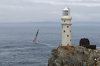 IRELAND, Fastnet Rock. 2nd July 2012. Volvo Ocean Race, Leg 9, Lorient to Galway. PUMA Ocean Racing powered by BERG leaves the Fastnet Rock.