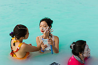 Chinese girls applying mud facials at the Blue Lagoon in Reykjavik, Iceland.