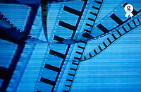 Transparent roll of 35mm movie film displayed on tv screen (Licence this image exclusively with Getty: http://www.gettyimages.com/detail/sb10066852ad-001 )