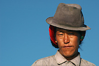 Portrait of a Tibetan man along the banks of the Lhasa river.