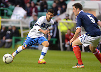 Italy U21 Lorenzo Insigne slides the ball past Scotland U21 Ross Perry