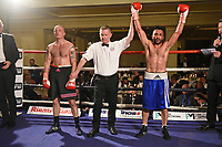 Ali Wyatt (blue shorts) defeats Dylan Draper during a Boxing Show at the Millenium Hotel on 11th May 2017