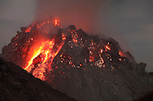 Glowing Rerombola lava dome of Paluweh Volcano during ash venting phase of 2012 Eruption, Flores, Indonesia.