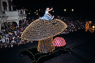 Orlando, Florida - Circa 1986. Disney character Alice and the Cheshire Cat greet the audience at the Main Street Electrical Parade. The Main Street Electrical Parade was created by Bob Jani and Ron Miziker, and first appeared at Disney World on June 11, 1977. Disney World is a world-renowned entertainment complex that opened October 1, 1971 in Lake Buena Vista, FL. Now known as the Walt Disney World Resort, the property covers 25,000 acres and has an annual attendance of 52.5million people.