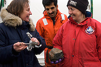 Scientists excited to secure  samples collected from the seafloor of the Arctic Ocean.