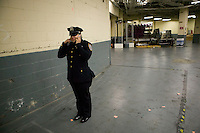 29 December 2005 - New York City, NY - Newly sworn in Police Officer Yadira Zeno calls her parents after graduating with the NYPD Class of 2005, December 29, 2005, in New York City, at the Madison Square Garden in New York City. About 20% of the 1,735 new police officers sworn in during the ceremony are female.
