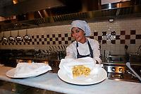 Roma 11 Giugno 2012.Apre Eataly Roma ,nell'ex Terminal Ostiense, quattro piani per una superfice  di 17 mila metri quadri,  ristoranti, caseificio, forno del pane, l'angolo delle fritture,  bar, paninoteche, negozi di alimentari, tutto della migliore qualità italiana..Opens Eataly former Roma Terminal Ostiense, four plans for an area of ??17 thousand square meters, ,restaurants, cheese factory, bread oven , the angle fried food, cafes, sandwich shops, food stores, with an emphasis on Italian.