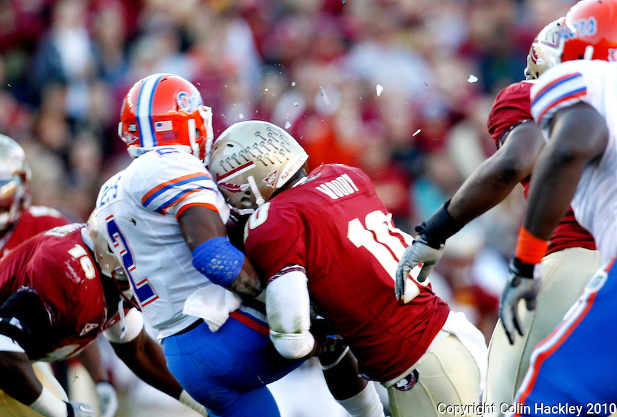 TALLAHASSEE, FL 11/27/10-FSU-UF FB10 CH-A hit from Florida State's Nick Moody shatters the plastic shield of the Univ. of Florida's Jeffery Demps during first half action Saturday at Doak Campbell Stadium in Tallahassee. .COLIN HACKLEY PHOTO