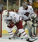 10/22/04 Omaha, NE University of Nebraska at Omaha goalie  Chris Holt and Dan Knapp stop a Western Michigan University shot at the Qwest Center Omaha...(Chris Machian/Prairie Pixel Group)
