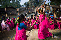 47 year old Sampat Pal Devi (right), founder and leader of the 10,000 strong 'Gulabi Gang' (Pink Gang), trains other women in the group to fight with lathis (traditional Indian sticks). In the badlands of Bundelkhand, one of the poorest parts of one of India's most populous states, a gang of female vigilantes have sprung up to fight the oppression of a caste-ridden, feudalistic and male dominated society. In a land where dowry demands and domestic and sexual violence are common, the 'Gulabi Gang', so called for their uniform of shocking pink saris, are picking up their lathis to fight against corruption and violence against women.
