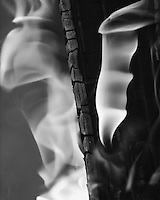 Flames of fire flowing upward in hypnotic fashion.<br /> Converted here to high contrast black &amp; white.